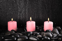 Candles and pebbles Stock Photography