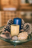 Candles and pinecones. Tray decorated with candles and pinecones Stock Photography