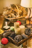 Candles and pinecones. Tray decorated with candles and pinecones Royalty Free Stock Photography