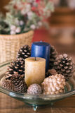 Candles and pinecones. Tray decorated with candles and pinecones Royalty Free Stock Photos