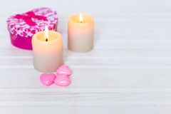 Candles , pink hearts. A gift on a white wooden background. Valentine's Day . Card Stock Image