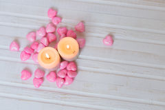 Candles and pink hearts. On a white wooden background. Valentine's Day. Card Royalty Free Stock Image