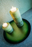 2 candles on the plate. Candles plate evening romantic light Royalty Free Stock Image