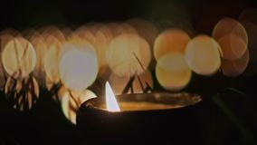 Candles on pond in religion ceremony