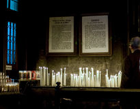 Candles with prayers in catholic church Royalty Free Stock Photo