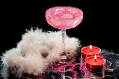 Calm, romantic, pink drink and candles royalty free stock photography