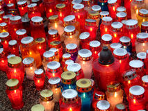 Candles on the rain. Candles in colors staying in the autumn rain Royalty Free Stock Image