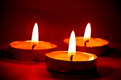 Candles on the red Stock Photography