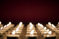 Candles on red background, all saints day concept Stock Images