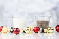 Candles With Red And Gold Christmas Decorative Balls. On Blurred Background With Bokeh Royalty Free Stock Photo