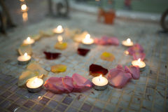 Candles red pink yellow rose petals big heart Royalty Free Stock Photos
