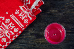 Candles and red plaid. On a dark wooden background Royalty Free Stock Photo