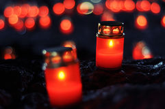 Candles in red stands Royalty Free Stock Image