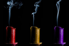 Candles red yellow and purple color faded Royalty Free Stock Photos