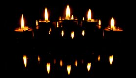 Candles and reflections. Shot of five candles and their reflections Stock Images