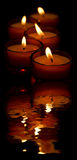 Candles and reflexion. Some candles and their reflexion Royalty Free Stock Photo