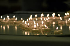 Candles of remembrance for child loss. Candles of remembrance arranged on table to grieve for child loss Royalty Free Stock Photography