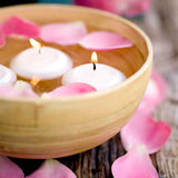 Candles and rose leaves Royalty Free Stock Photos