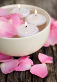 Candles and rose leaves Stock Photography