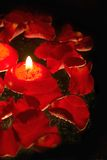Candles with rose petals. Floating red candles with rose petals Royalty Free Stock Photography