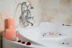 Candles and rose petals Stock Images
