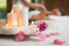 Candles and rose petals on massage table Royalty Free Stock Photography
