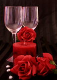 Candles and Roses. Wine glasses, roses and a red candle royalty free stock photo