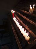 Candles in a row. Let's pray for each other stock photography