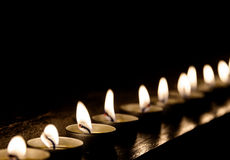 Candles in a row Royalty Free Stock Images