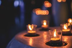 Candles in a row in Spa Zone. Some candles in a row in spa zone for relaxing time. It is late night stock photo