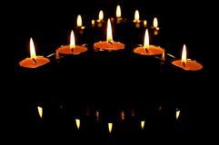 Candles and it's shadows. The amazing shadows of the burning candles Stock Images