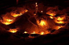 Candles on sand Stock Image