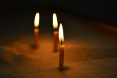 Candles in the sand Royalty Free Stock Photos