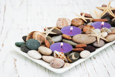 Candles with sea pebbles, starfish and sea shells Royalty Free Stock Image