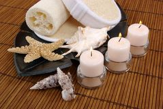 Candles and Seashells. Aromatic candles, seashells and sponges Stock Photos