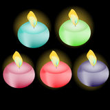 Candles set. Set of colored candles on black background Stock Images