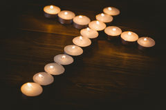 Candles in shape of cross Royalty Free Stock Photos