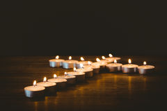 Candles in shape of cross Royalty Free Stock Images