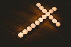 Candles in shape of cross Stock Images