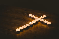 Candles in shape of cross Stock Photos