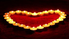Candles in the shape of heart stock footage