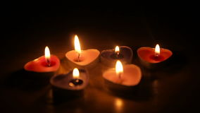 Candles in the shape of hearts are burning in the dark. Full hd video stock video