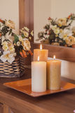 Candles on a sideboard. Tray decorated with candles on a sideboard. toned image Royalty Free Stock Photos