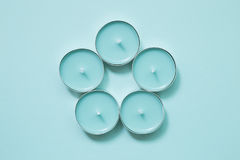 Candles on skyblue background. Many candles on skyblue background royalty free stock photos