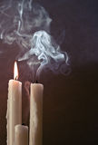 Candles and smoke Stock Images