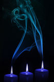 Candles with smoke. Blue candles and smoke abstract background royalty free stock image