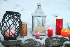 Candles on the snow. Burning candles in the snow Royalty Free Stock Image