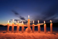 Candles in the snow outdoors Royalty Free Stock Photography