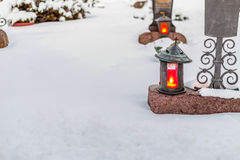 Candles in a snowy cemetery Royalty Free Stock Photography