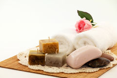 Candles and Soap. Aromatic candles, oatmeal soap, and towels for spa Stock Image